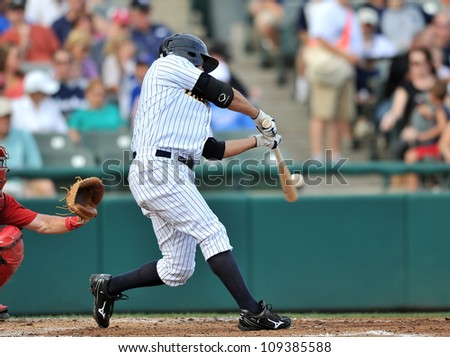 TRENTON, NJ - JULY 29: Trenton batter Kevin Mahoney swings at a pitch during an Eastern League baseball game July 29, 2012 in Trenton, NJ. - stock photo