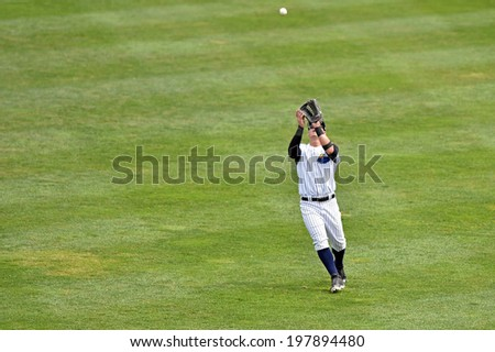 TRENTON, NJ - JUNE 8: Trenton Thunder right fielder Tyler Austin (17) settles under a fly ball for an out during the Eastern League minor league baseball game played June 8, 2014 in Trenton, NJ.