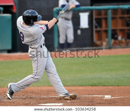 TRENTON, NJ - MAY 23: Akron first baseman Chun Chen swings at a pitch  during the Eastern League baseball game against the Trenton Thunder May 23, 2012 in Trenton, NJ. - stock photo