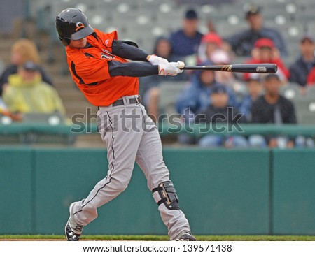 TRENTON, NJ - MAY 19: Bowie BaySox left fielder Caleb Joseph swings at a pitch during an Eastern League baseball game May 19, 2013 in Trenton, NJ. - stock photo