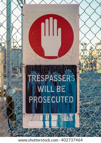 Trespassers Will Be Prosecuted Sign Outside An Electrical Power Transformer Substation - stock photo