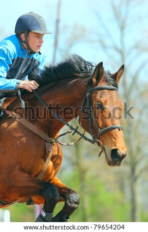 "TRESTINA - APRIL 09: Unidentified rider in action at ""Jump equestrian facilities"" on April 09, 2011 in Trestina (Czech Republic)"