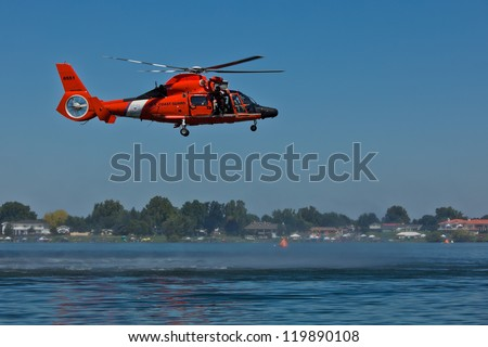 TRI-CITIES, WA - JULY 28: USCG Eurocopter HH-65C Dolphin Helicopter Rescue Demonstration Flight at the Lamb Weston Columbia Cup July 28, 2012 on the Columbia River in Tri-Cities, WA. - stock photo