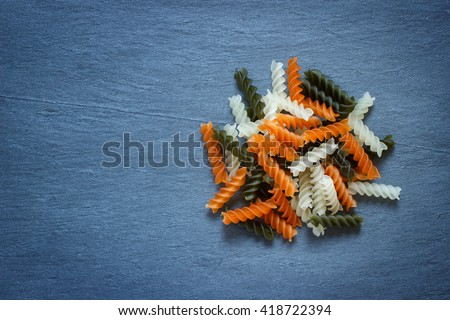 Tri color Fusilli pasta on natural background
