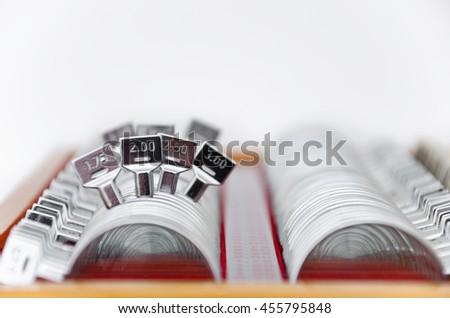 trial lens kit for eye exam on white - stock photo