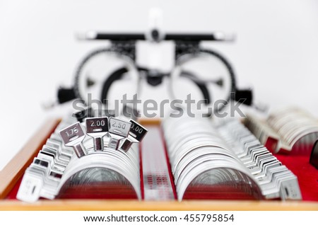 trial lens kit with frame for eye exam on white - stock photo