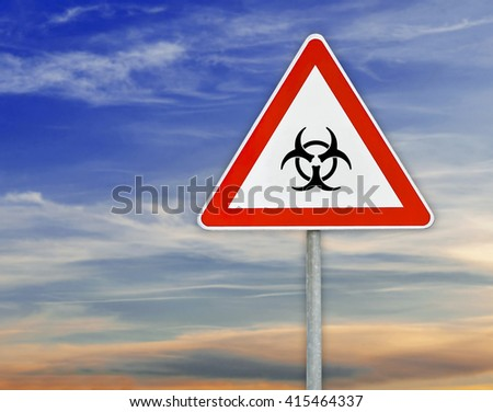 Triangle on rod road sign radiation danger with cloudy sky