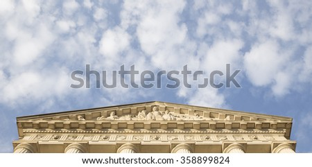 Triangle Pediment with frieze of the building in Washington DC. Copy place. Looks like arrow pointed to the sky - stock photo