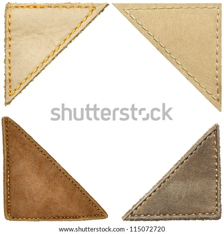 Triangle shape leather labels, corners. - stock photo