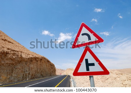 Triangle traffic sign on the highway to the Dead Sea. - stock photo