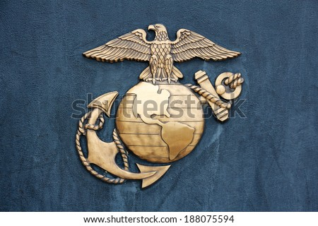 TRIANGLE, VA, USA - LATE 2010: Insignia of the United States Marine Corps in golden burnished metal on a dark blue-gray wall at the Museum of the Marine Corps at Triangle, VA, USA, in late 2010. - stock photo