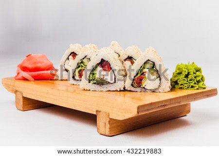 Triangular roll on a wooden board on a white background
