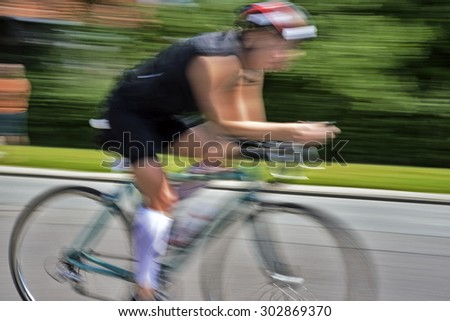 Triathlon race cyclists at high speed and closeup. Fredericia in Denmark. - stock photo