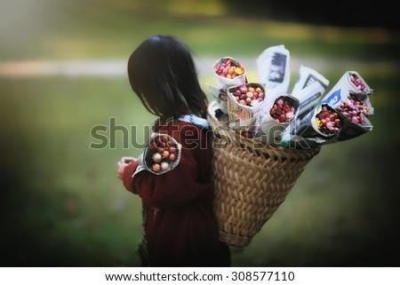 Tribal children sell the flower, Art style - stock photo