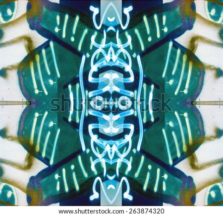 Tribal Design totem has a native, ethnic feel in blue, green and white repeats seamlessly. - stock photo