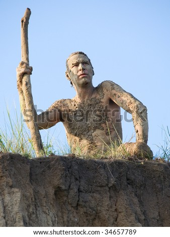 tribal leader, or just naked people perepachkanny clay - stock photo