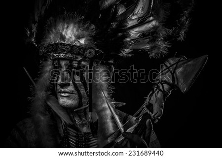 tribal Native, American Indian chief with big feather headdress - stock photo