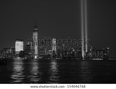 Tribute in Light and Lower Manhattan skyline along the Hudson River. - stock photo
