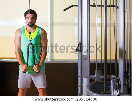 Triceps pressdown high pulley workout man at gym exercise - stock photo