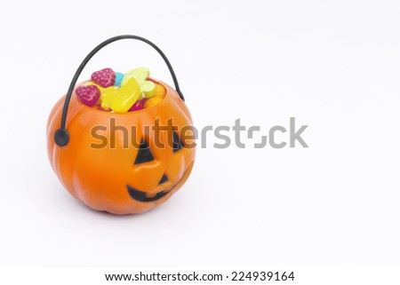 Tricks or Treats Halloween Jack O Lantern. Festive Basket with Sweets. White background - stock photo