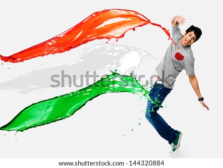 Tricolor paints being splashed on a man - stock photo