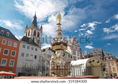 TRIER, GERMANY - SEPTEMBER 11, 2014: main market square in Trier. It lies in the historical city center with a lot of old buildings from renaissance, baroque and classicism - stock photo