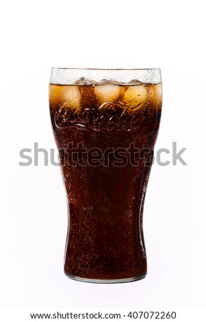 TRIESTE, ITALY - April 14, 2016, Glass of Coca-Cola. Isolated on white Background. Coca Cola, Coke is the most popular carbonated soft drink beverages sold around the world
