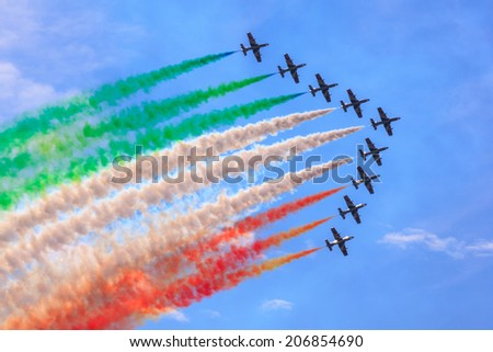 "TRIESTE, ITALY - JUNE, 01: View of Italian military airplane called frecce tricolore ""tricolor arrows"" in acrobatics on June 01, 2014 - stock photo"