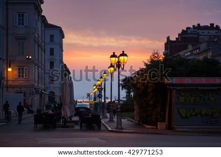 TRIESTE, ITALY - MAY, 25: View of illuminated street lantern at sunset on May 25, 2016