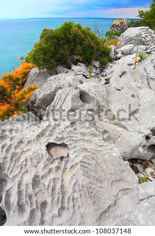 Trieste, Italy. Nature sanctuary The Rilke path, an extremely suggestive walk that starts from the Bay of Sistiana and runs along the coast on cliffs over the Adriatic sea to Duino Castle. - stock photo