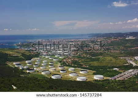 Trieste's oil terminal and a view of the city - stock photo