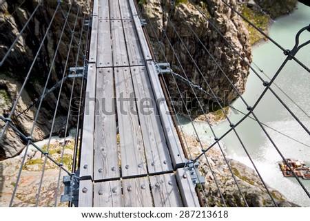 Trift Bridge, pedestrian-only suspension bridge in Alps. Canton of Berne. Switzerland - stock photo