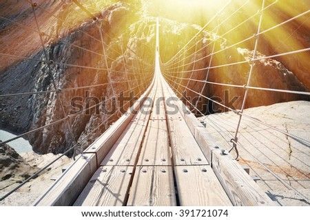 Trift Bridge, the longest 170m pedestrian-only suspension bridge in the Alps. Switzerland - stock photo