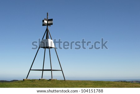 Trig Station against a blue sky background - stock photo