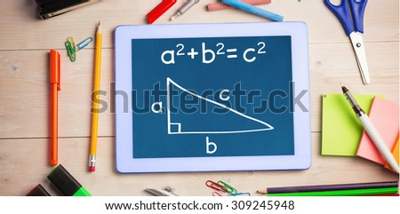 Trigonometry against students table with school supplies - stock photo