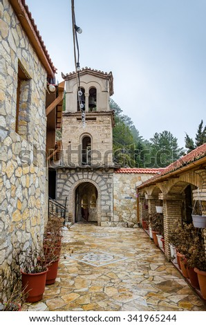 TRIKALA KORINTHIAS - GREECE FEBRUARY 8 2014: The Entrance of Agios Vlasios Monastery (St. Vlasios orthodox Monastery) located at Ano Trikala village in Corinthia - Greece. - stock photo