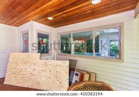 Trim for new kitchen windows and patched siding painted - stock photo