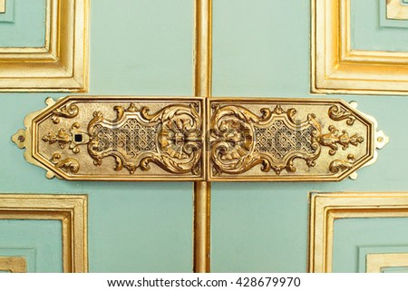 trim on the doors, the handle decorated with monograms and gold, the Livadia Palace - stock photo