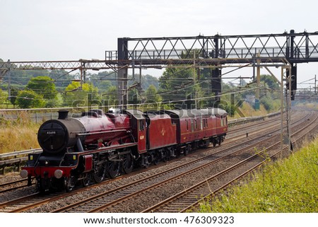 TRING, UK - AUGUST 25: Ex LMS Jubilee class steam loco 'Galatea' heads back to Crewe with a support coach having completed its tour of steam specials for the public on August 25, 2016 in Tring