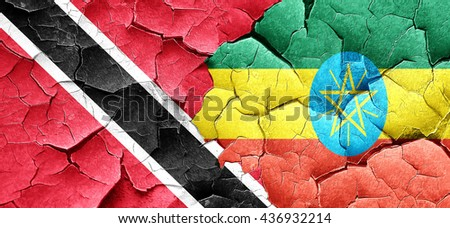 Trinidad and tobago flag with Ethiopia flag on a grunge cracked  - stock photo