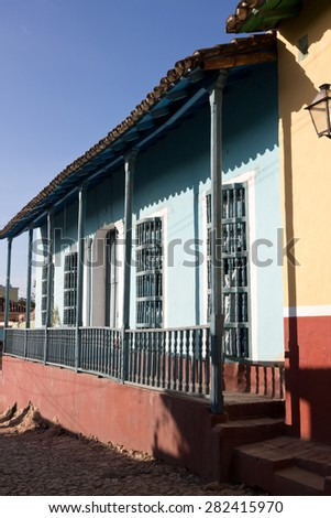 Trinidad, Cuba - Colonial house with traditional  wooden barrotes (window grate). Historic center street with houses often converted in casa particular- UNESCO World Heritage Site   - stock photo