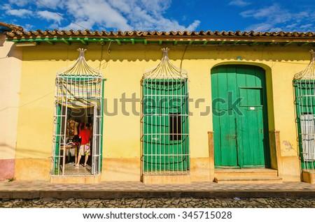 TRINIDAD, CUBA - DECEMBER 7, 2013: Colorful colonial houses on Trinidad street, Trinidad, Cuba - stock photo