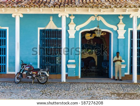 TRINIDAD, CUBA - DECEMBER 7, 2013: Turquoise blue and white facade of old colonial building in Trinidad, where colonial style is typical for towns in Cuba - stock photo