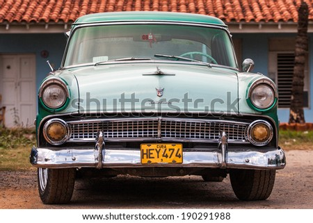 TRINIDAD, CUBA - FEBRUARY 14: classic American car on streets of Trinidad, where old vehicles become relic part of Cuban cities after Fidel Castor revolution in 1960's on February 14, 2011