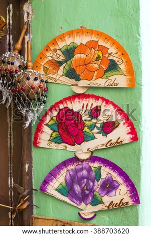 TRINIDAD,CUBA-FEBRUARY 5,2016:Oriental homemade fans for sale as souvenirs in the Caribbean Island - stock photo