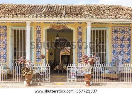 TRINIDAD,CUBA-JULY 5,2015: Facade of old colonial house turned into a restaurant. Private business are getting stronger after the economic changes of the Raul Castro government.