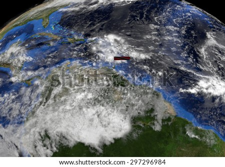 Trinidad flag on pole on earth globe illustration - Elements of this image furnished by NASA - stock photo