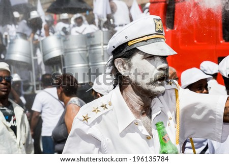 TRINIDAD WEST INDIES - FEB 5, 2008: Band of sailors with powder taking part in Carnival Tuesday celebrations on February 5, 2008 in Port Of Spain, Trinidad W. I. - stock photo