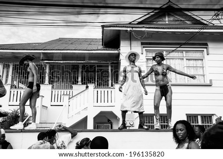 TRINIDAD WEST INDIES - FEB 4, 2008: Revelers provide entertainment as jouvert festivities wind down during Trinidad Carnival celebrations February 4, 2008 in Port Of Spain, Trinidad W. I. - stock photo