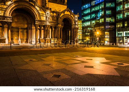 Trinity Church and the John Hancock Building at night, at Copley Square in Boston, Massachusetts. - stock photo